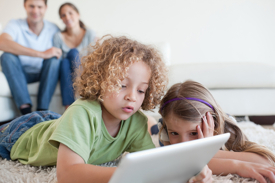 bigstock-young-children-using-a-tablet-28407926